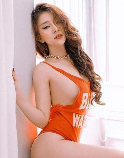 Seductive Chinese Hottie Teasing In Sexy Red T-Shirt